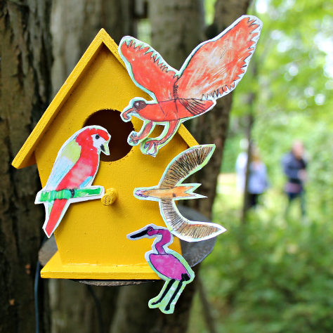 A lovely bright yellow bird nest box featuring illustrations by Joe Murray, aged 8 years.