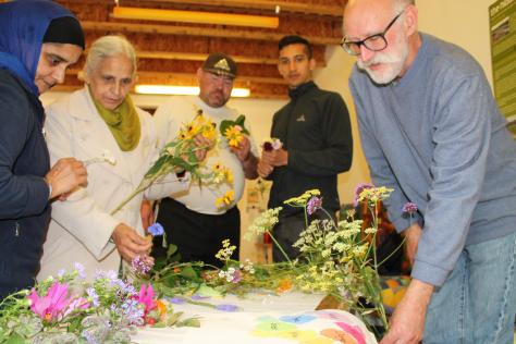 Volunteers choosing which flowers to plant