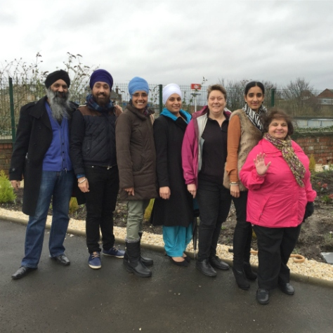 A group from the Gurdwara and The Hidden Gardens don't let the weather faze them!