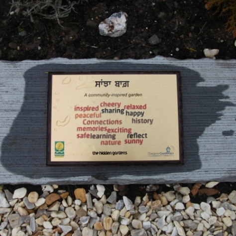 The plaque commemorating the Gurdwara shared garden.